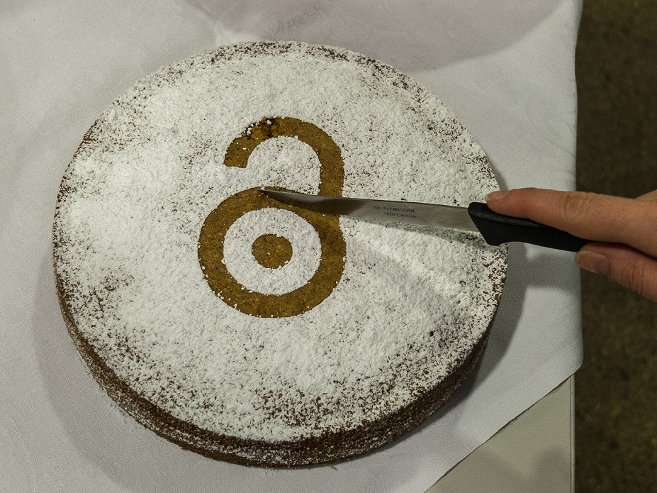 An image of an Open Access cake being sliced